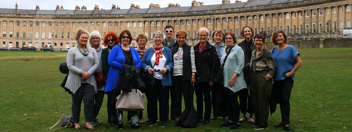 A group of women from the Grand British Textile Tour standing in front a the Crescent in Bath