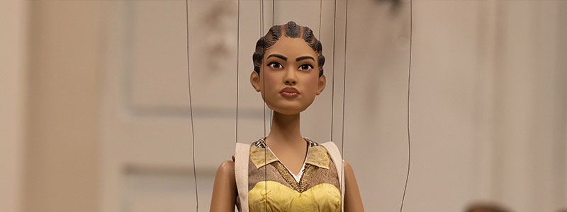 A puppet version of a model wearing a Moschino top.